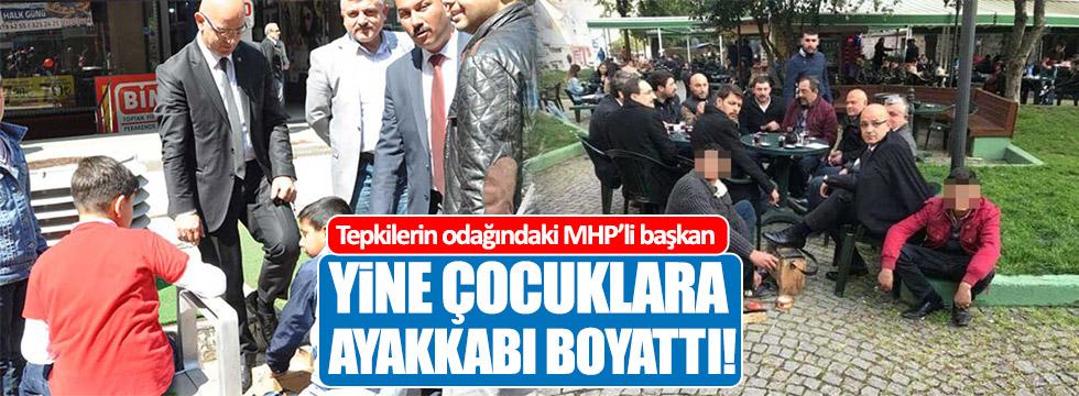 Tepkilerin odağındaki MHP'li başkan yine çocuklara ayakkabı boyattı!