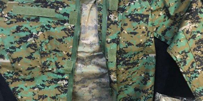 Teröristlere askeri kamuflaj götürürken yakalandılar