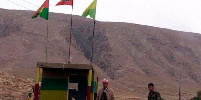Irak ordusu Sincar'da örgüt sembollerini kaldırdı