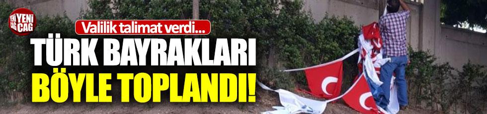 Valilik indirin dedi: İzmir'de bayraklar yerlerde sürülerek toplandı