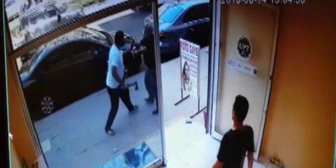 Döviz bürosunda baltalı silahlı kavga