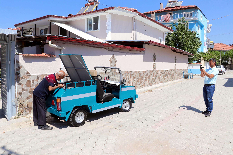bicak-ustasi-capa-makinesi-motoruyla-ustu-acik-araba-yapti-5416-dhaphoto8.jpg