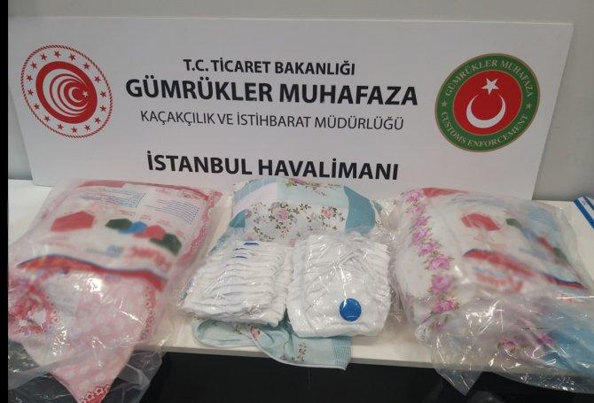 ek-fotograf-istanbul-havalimaninda-yastiklarin-icine-saklanan-87-bin-500-maske-ele-gecirildi-8374-dhaphoto2.jpg